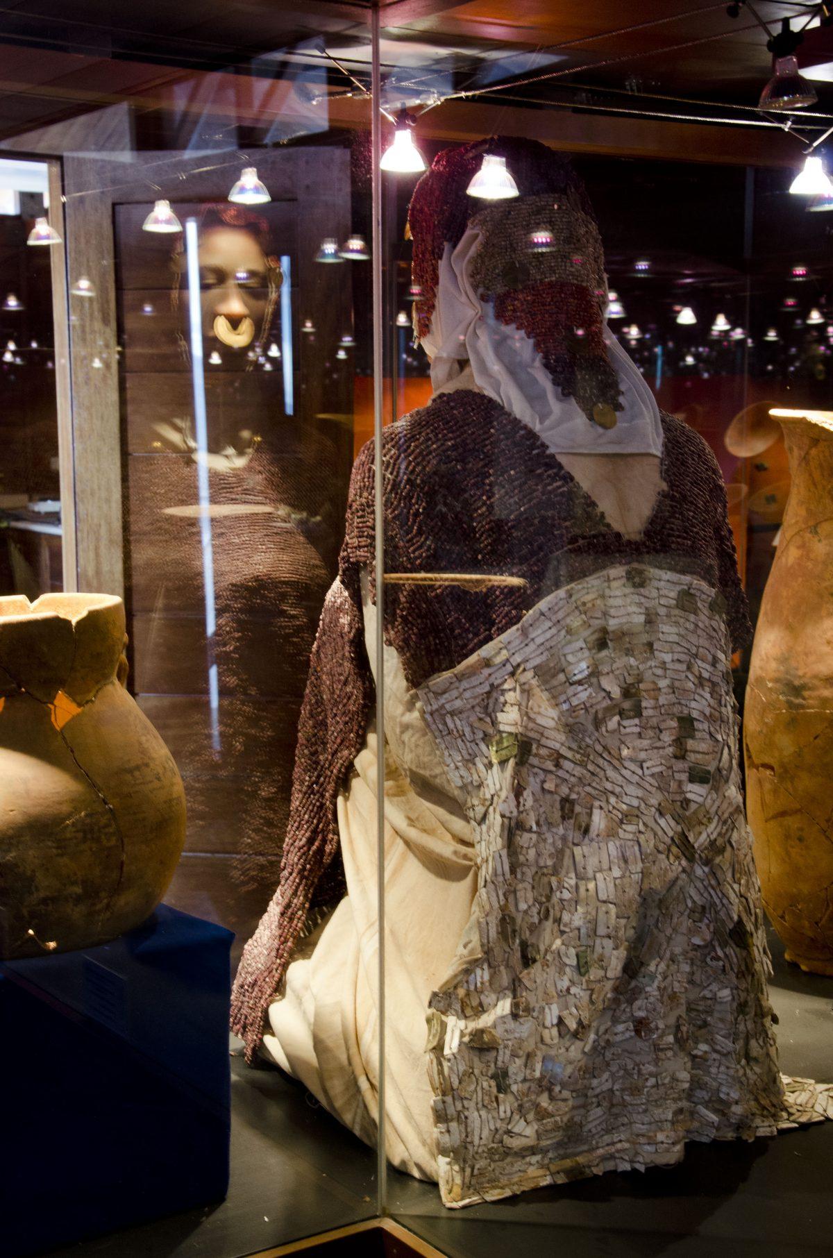 Reverse side of a beaded, shell poncho; La Florida Museum | ©Angela Drake