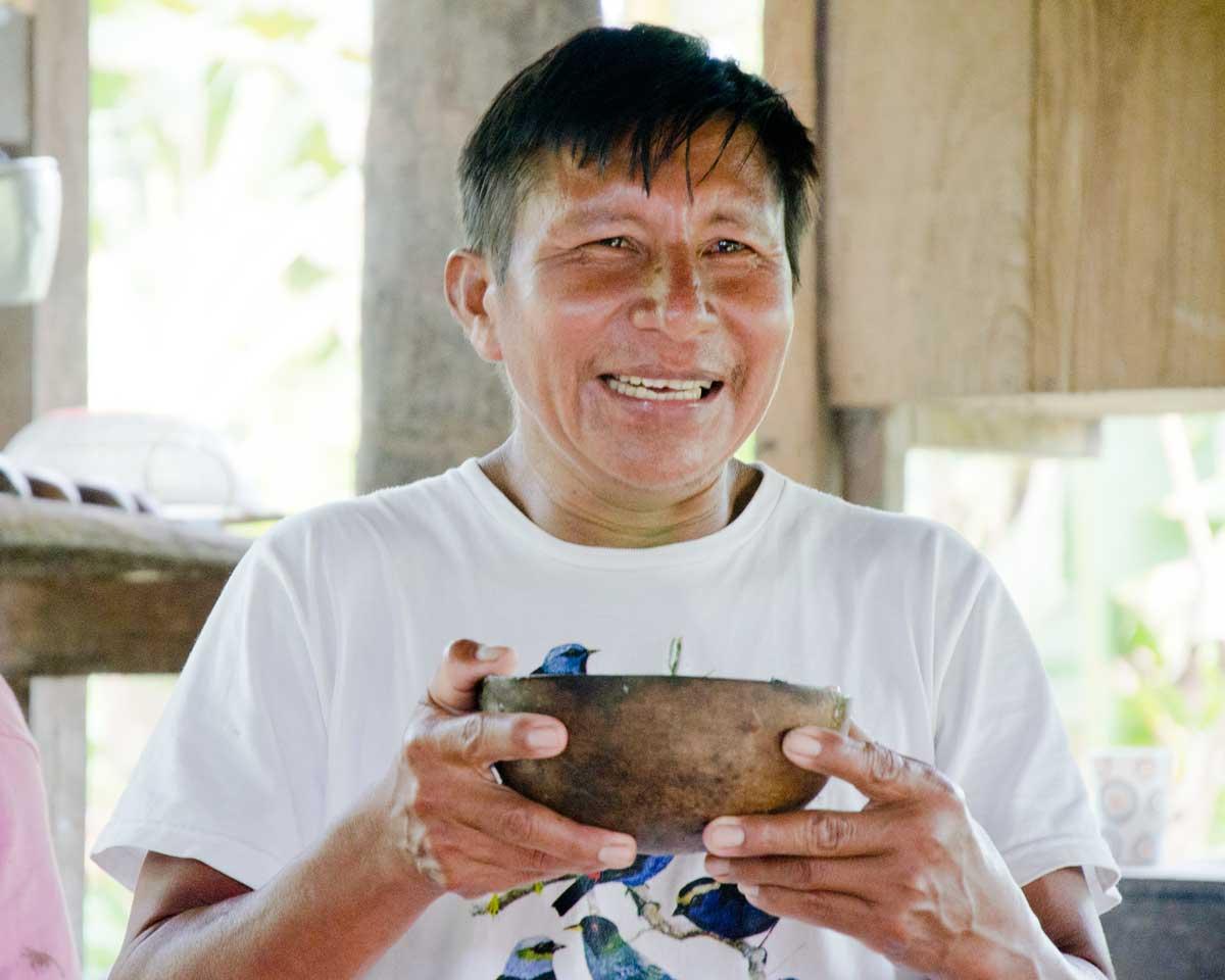 Our guide José drinking Chicha de Yuca | ©Angela Drake