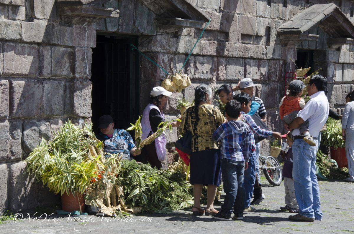 Purchasing bouquets for Palm Sunday, San Francisco Plaza, Quito, Ecuador | ©Angela Drake