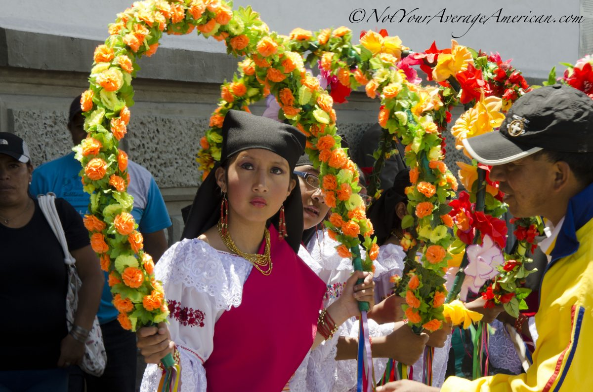 Quiteña waiting for her turn on stage, Palm Sunday, Quito | ©Angela Drake