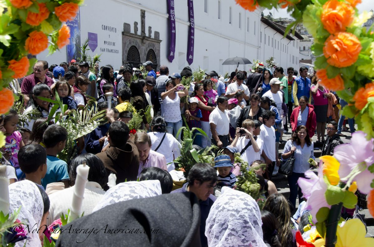 A priest blesses the crowd with holy water; San Francisco Plaza, Quito, Ecuador | ©Angela Drake