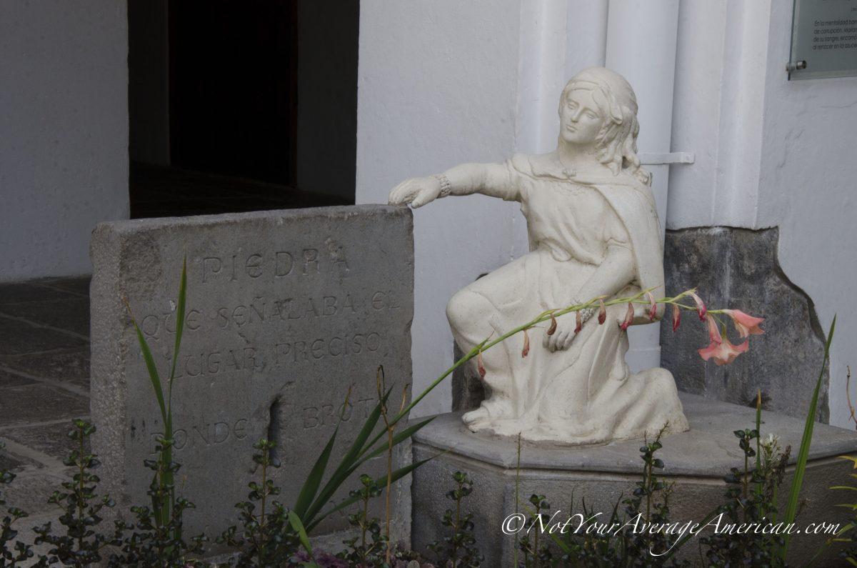 A small statue in the inner courtyard; Museo de Carmen Alto, Quito, Ecuador | ©Angela Drake