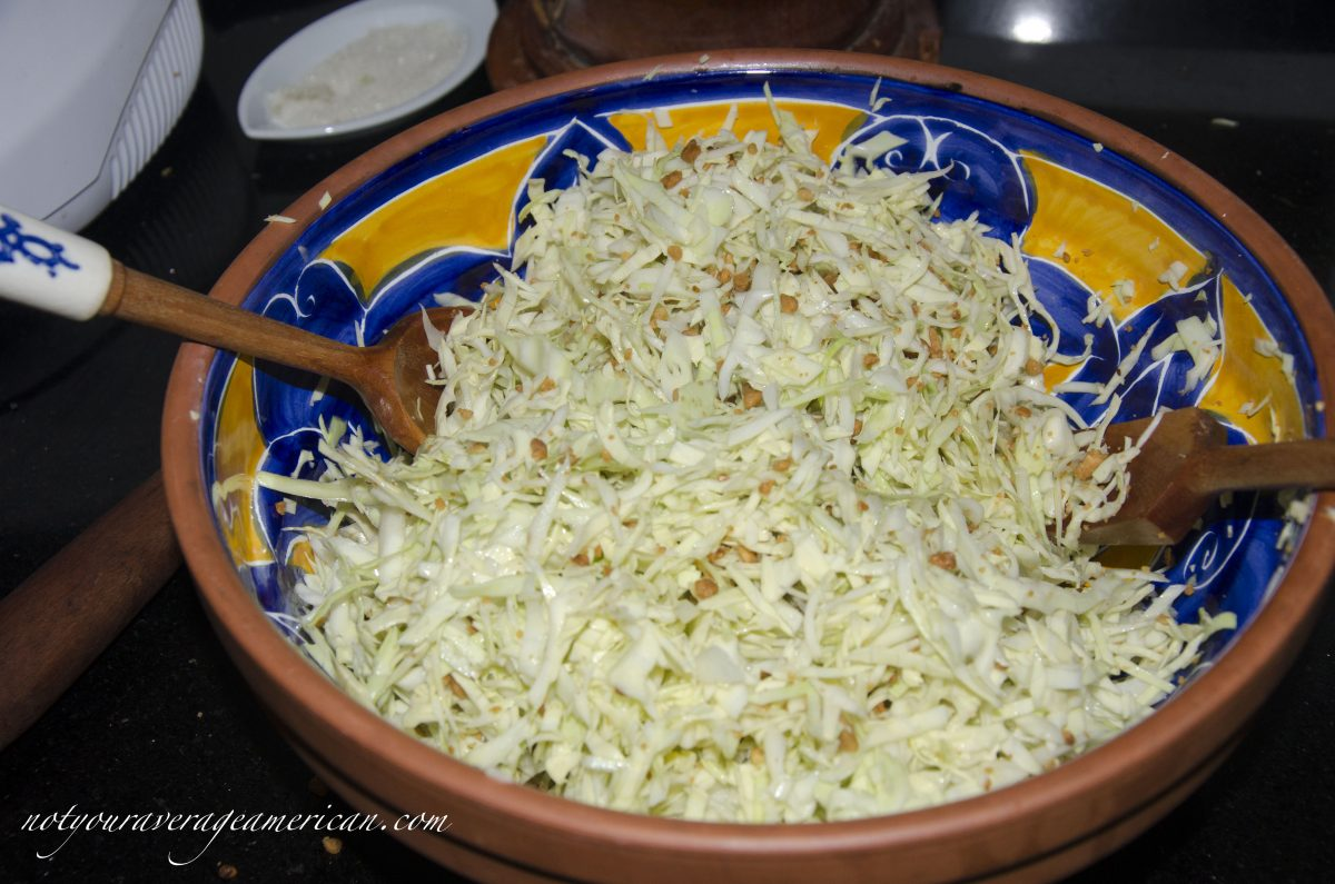 Toss the the ground, roasted peanuts with the coleslaw.