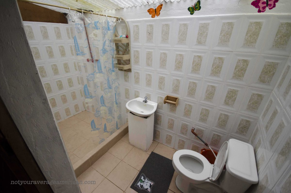 The bathroom in the cabin is clean and spacious. It also has hot water; Panticucho, Baños, Ecuador | ©Angela Drake