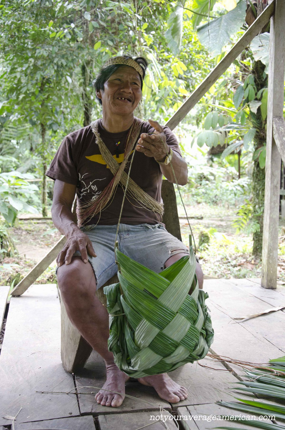 Our Huaorani guide, Bai, taught us how to make a basket that could be used for carrying freshly hunted meat or just harvested plants from the jungle   ©Angela Drake