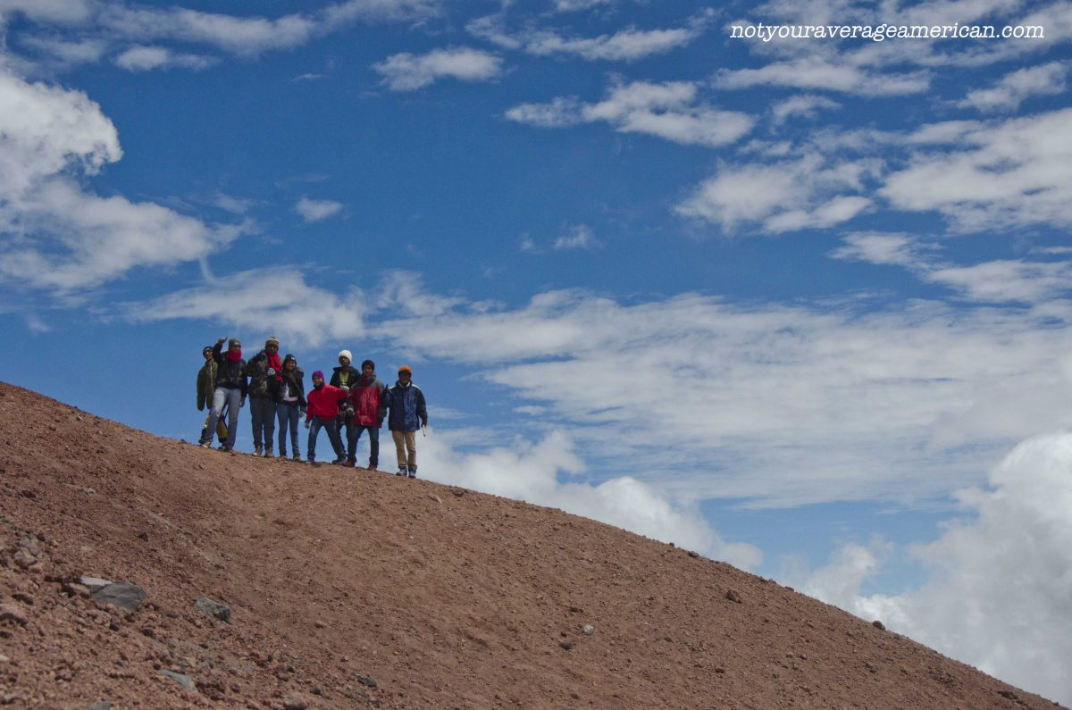 A group of Colombians proudly pose on a ridge, Cotopaxi National Park, Ecuador   ©Angela Drake