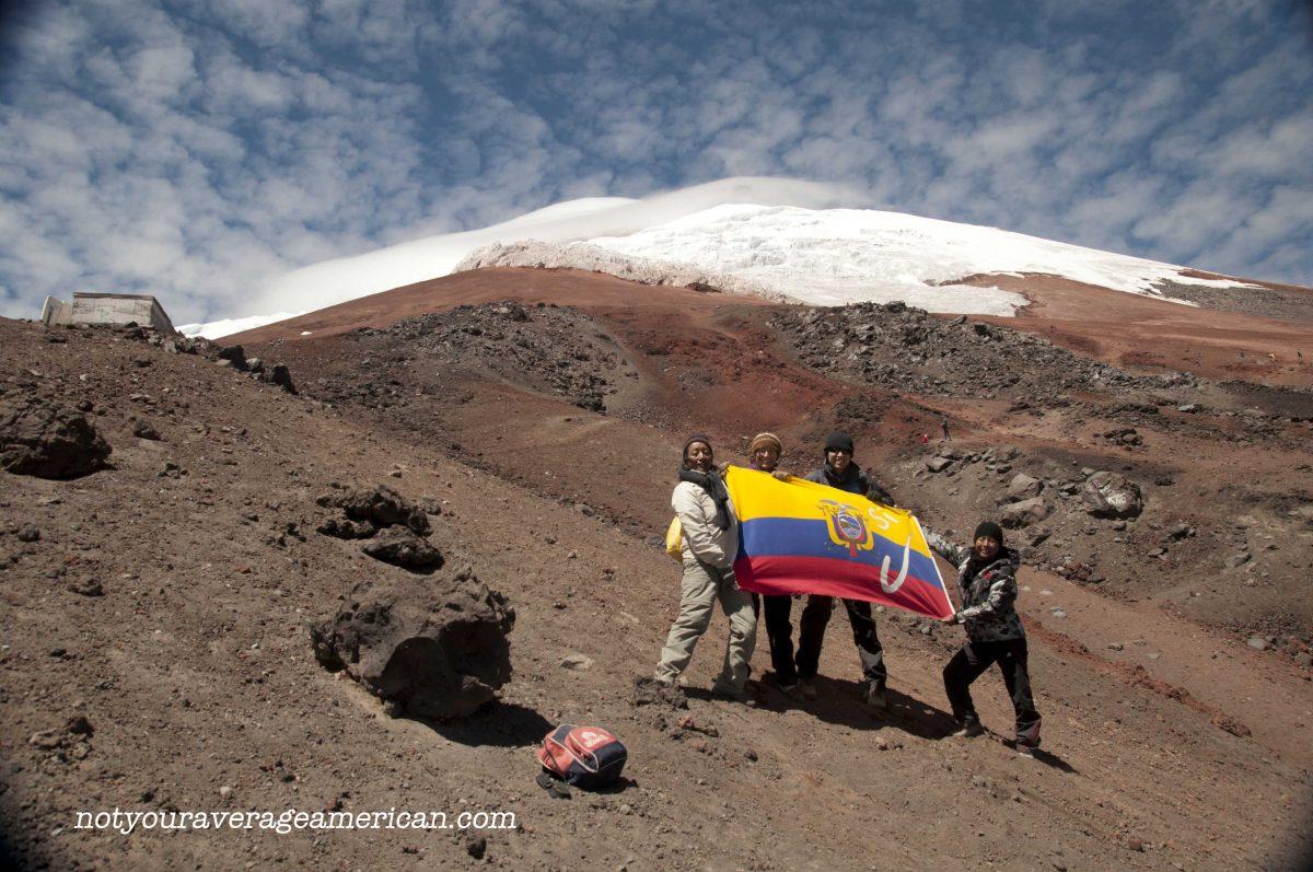 Quiteños & Author holding the Ecuadorian Flag, Cotopaxi National Park, Ecuador   ©Angela Drake