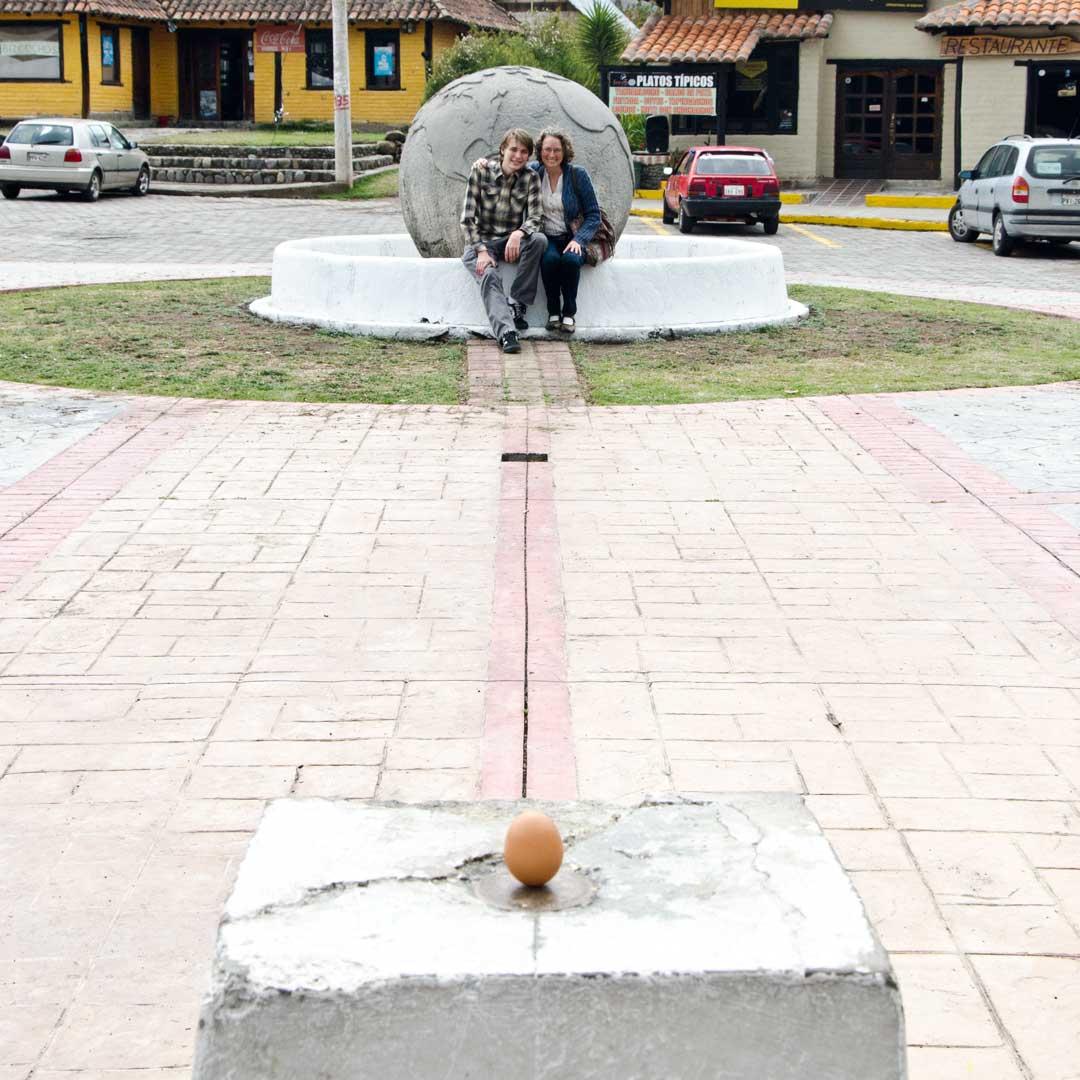 Posing with a Balanced Egg at the authentic Mitad del Mundo; Buena Esperanza, Cayambe, Ecuador | ©Angela Drake