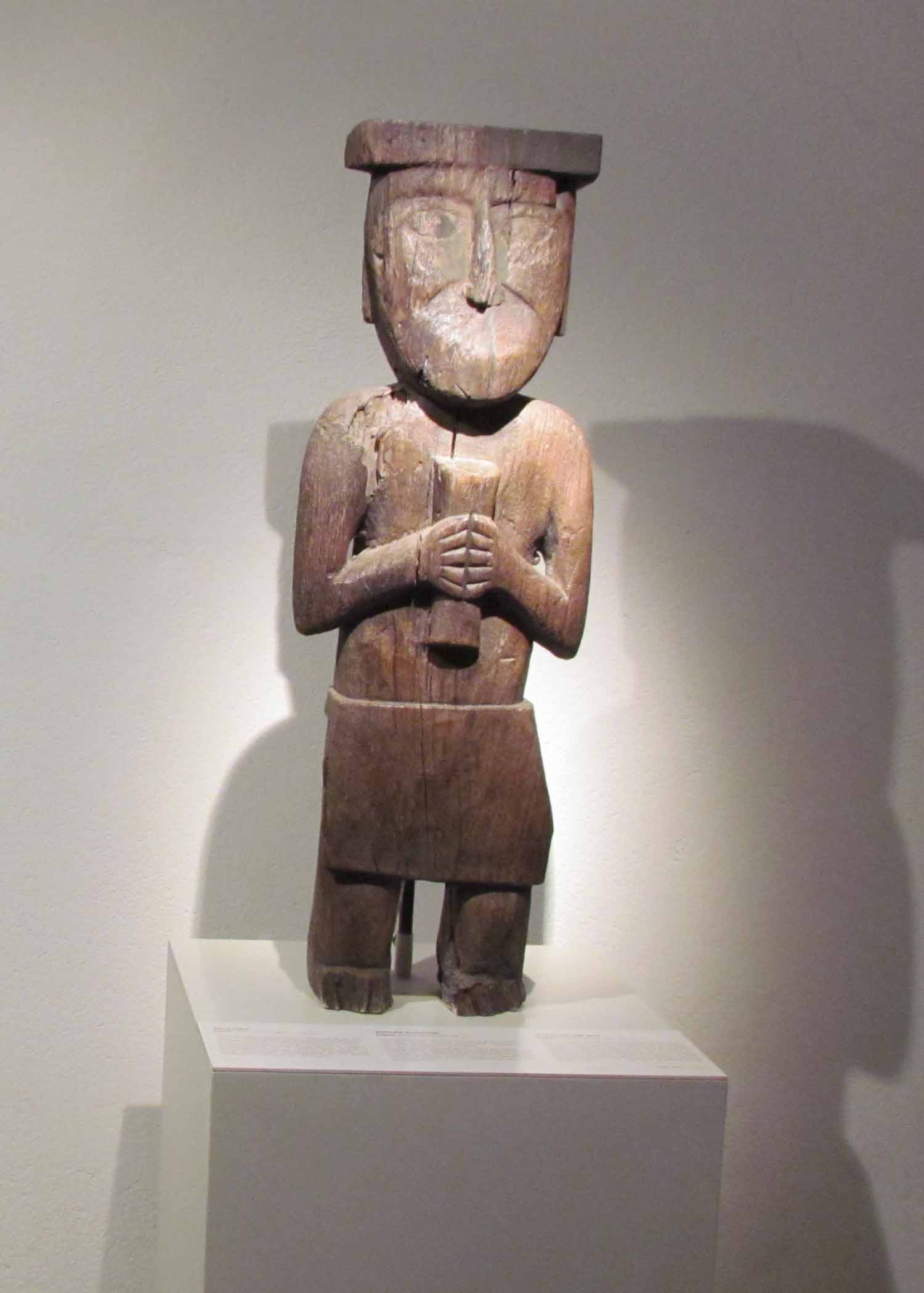 A wood carved figure on display at the Pre-Colombian Art Museum, Cusco, Peru   ©Angela Drake