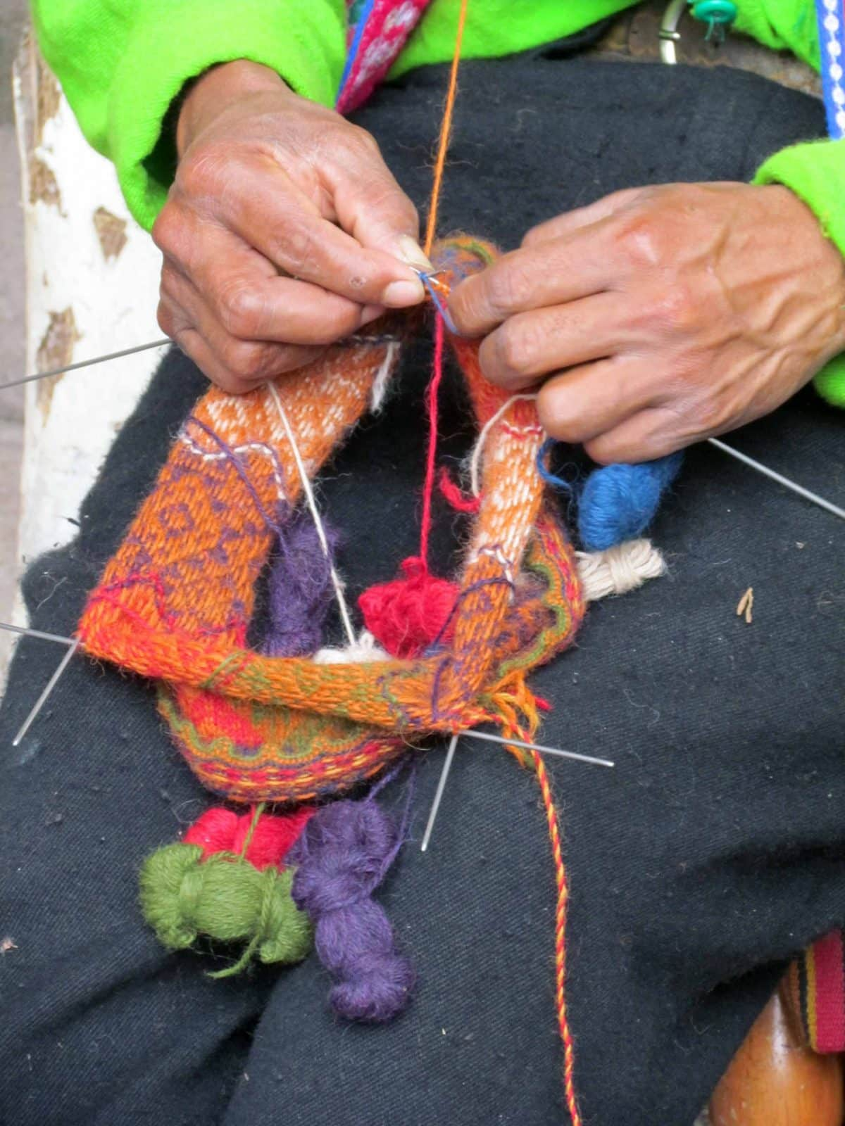 Knitting a traditional woolen hat; The Center for Traditional Textiles of Cusco, Peru   ©Angela Drake