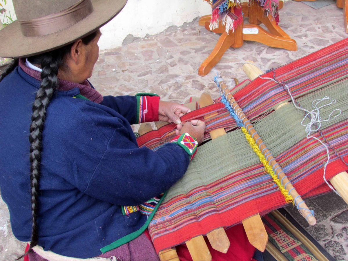 Using a backstrap loom; The Center for Traditional Textiles of Cusco, Peru   ©Angela Drake
