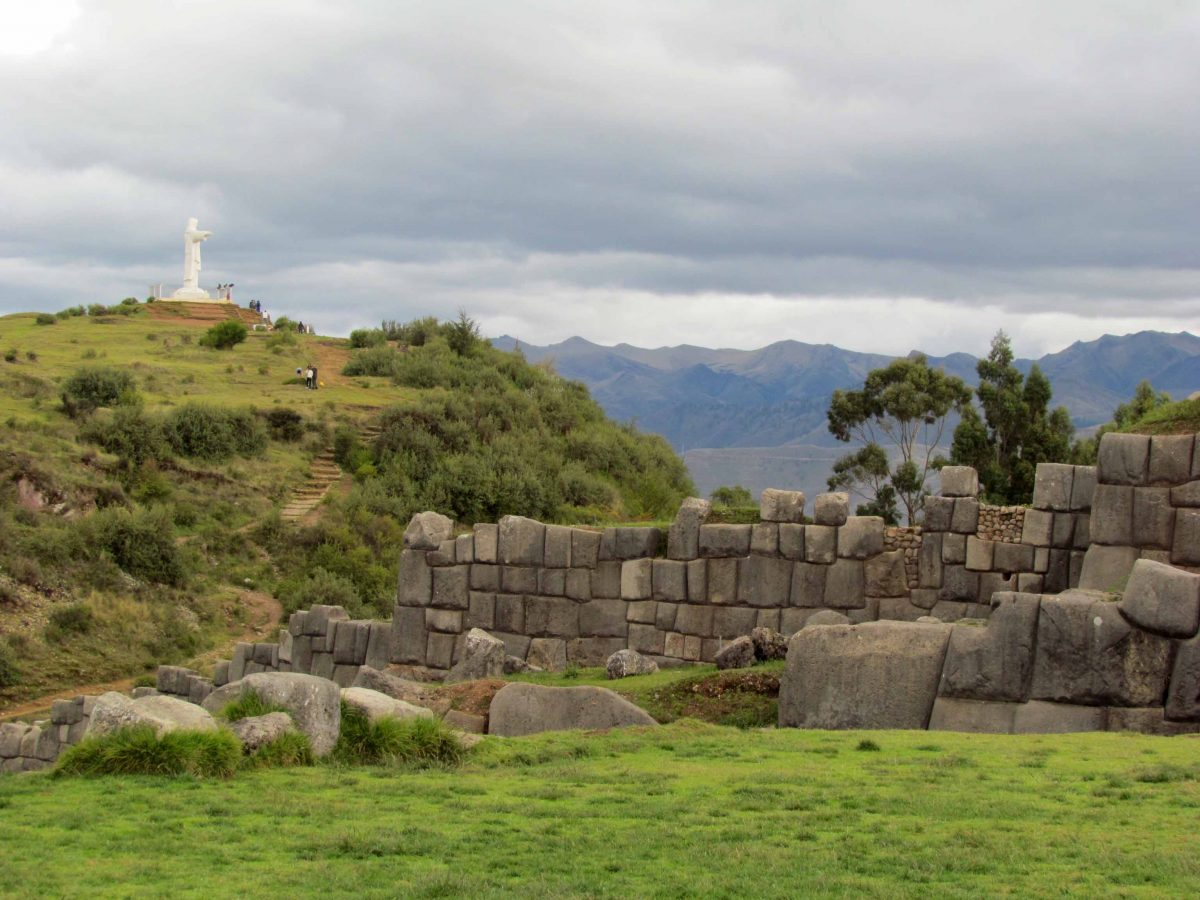 Saqsayhuamán with statue of Jesus in the background; Cusco, Peru | ©Angela Drake