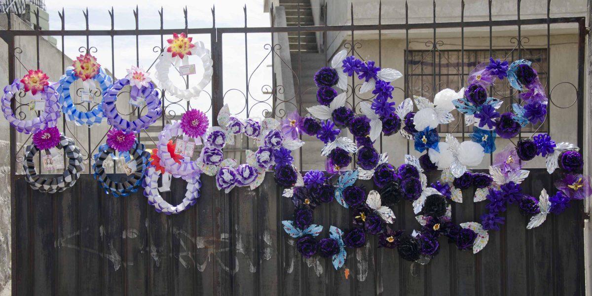Wreaths of plastic flowers last longer than bouquets, Calderón, Quito, Ecuador   ©Angela Drake