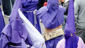 Cucurucho Wearing a Sign