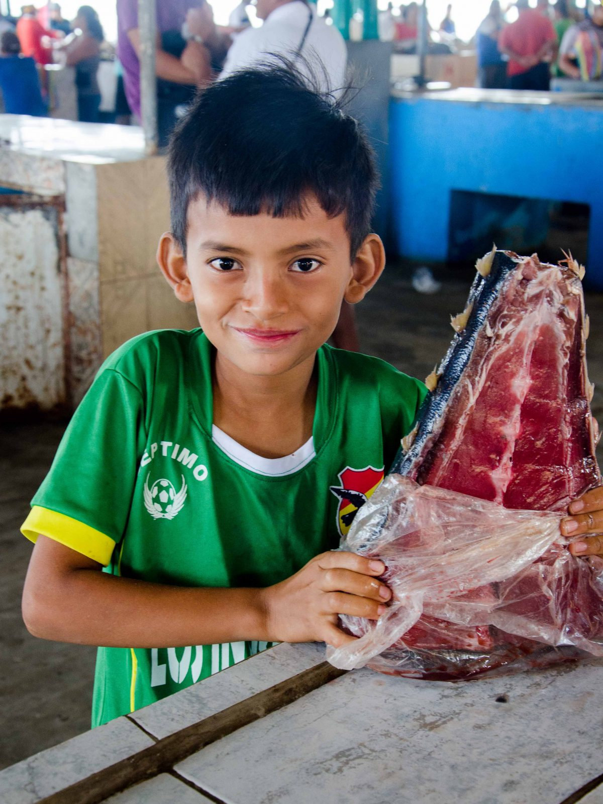 A young Manteño proudly displays his family's tuna for sale, Ecuador   ©Angela Drake / Not Your Average American