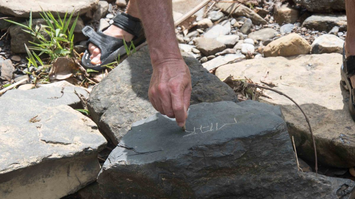 Using chalk found by the river, Cascadas Yanayacu, Napo Province, Ecuador