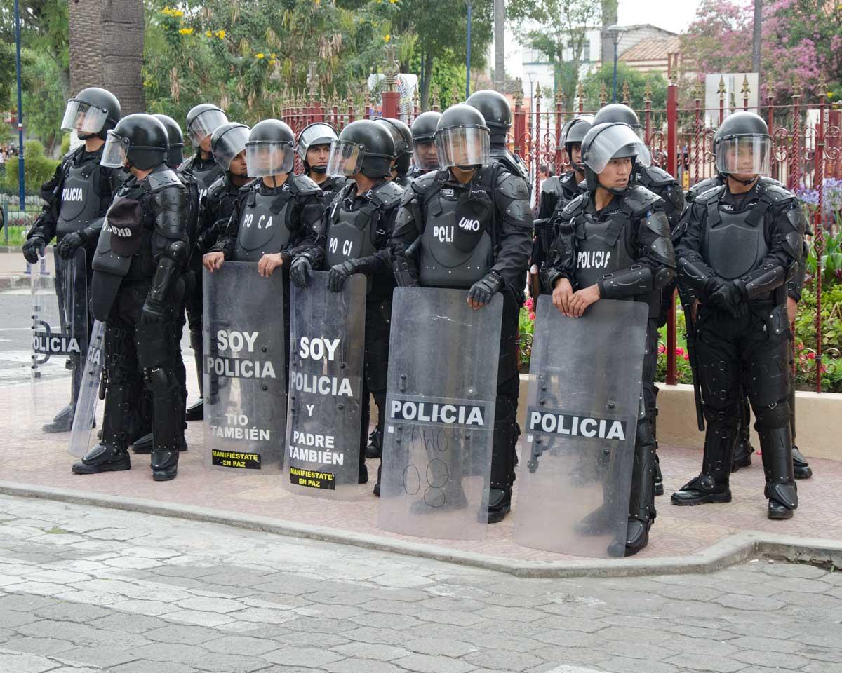 Police at the Taking of the Plaza, Intiraymi, Cotacachi, Ecuador | ©Angela Drake