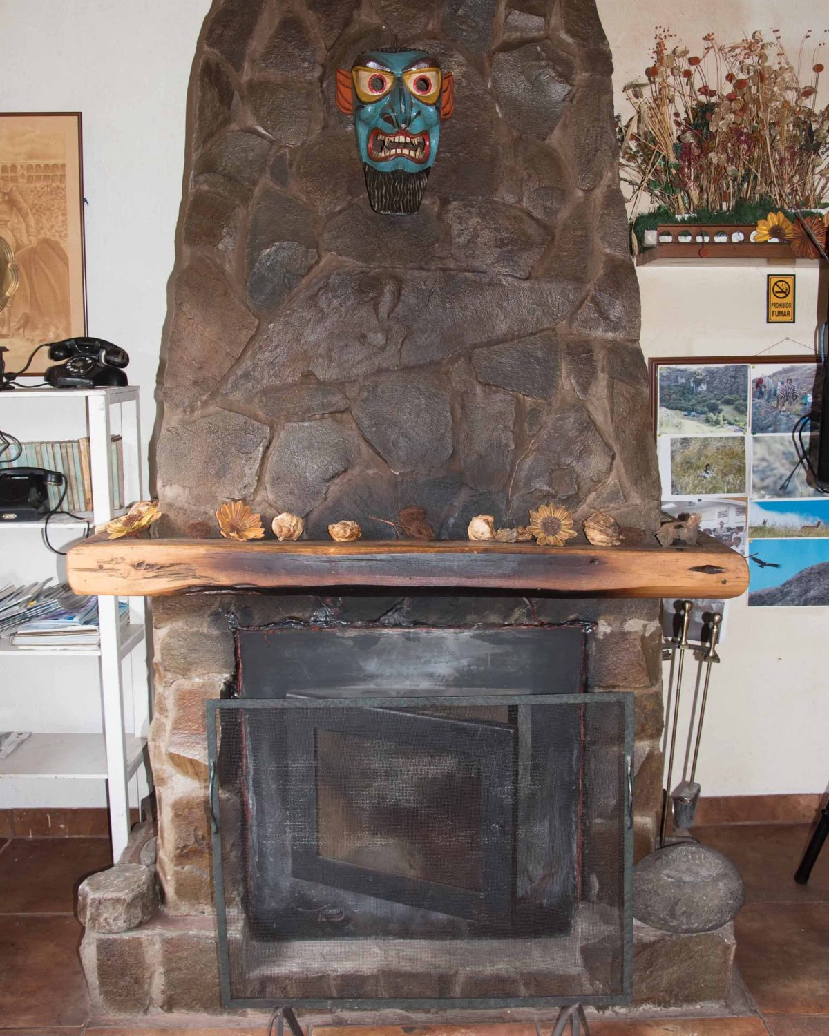 The fireplace in the dining room at Guayatra Lodge ©Angela Drake / Not Your Average American