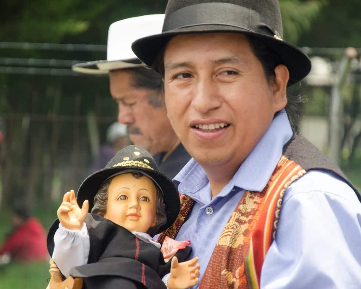 Carrying the Baby Jesus, Kapak Raymi Festival | The Kapak Raymi Procession in Quito, Ecuador | © Angela Drake