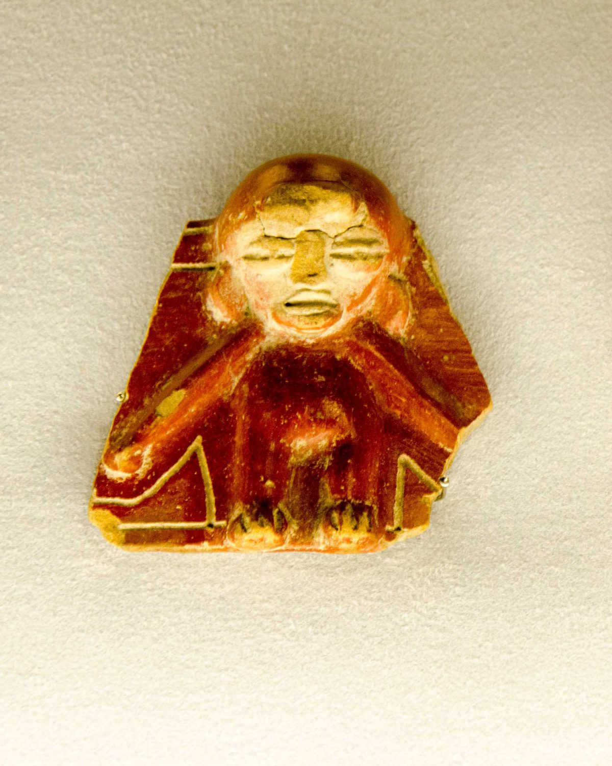 A pottery fragment of displayed at the Weilbauer Museum, La Catolica (PUCE), Quito, Ecuador