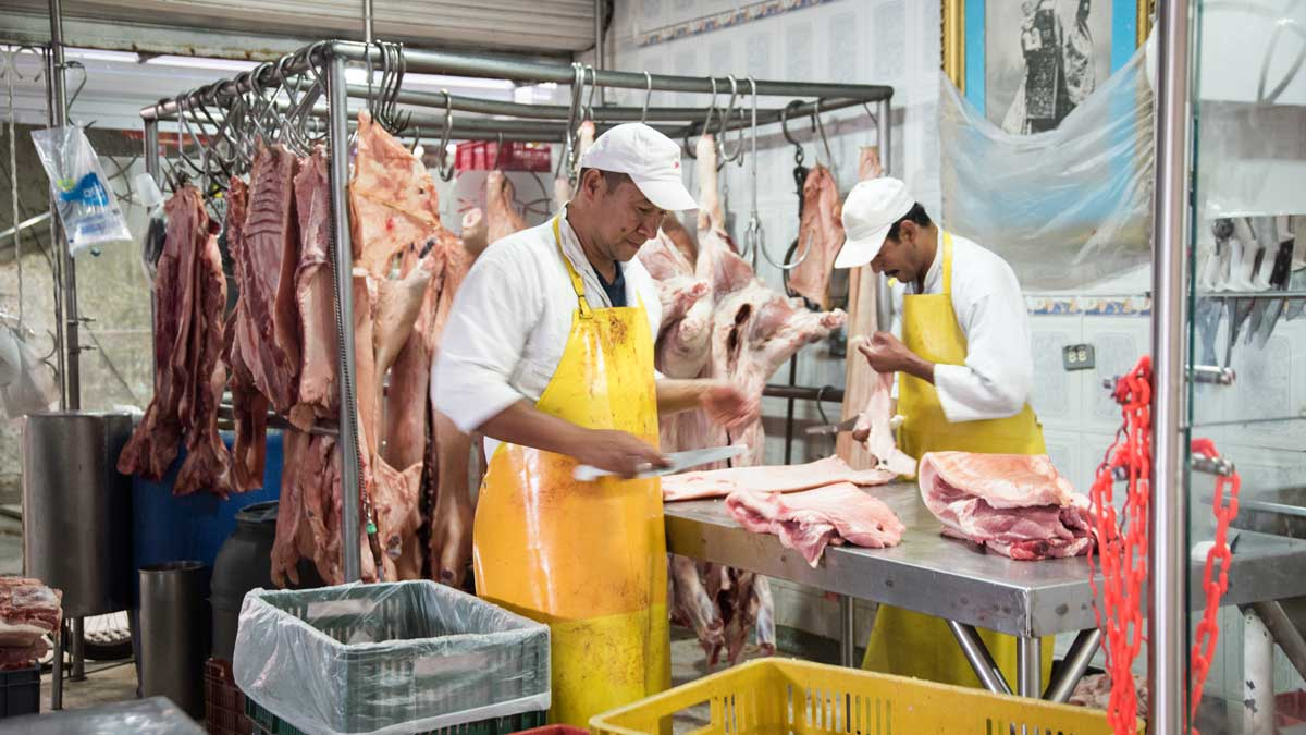 Butchers at work, Plaza Mercado de Paloquemao   ©Angela Drake