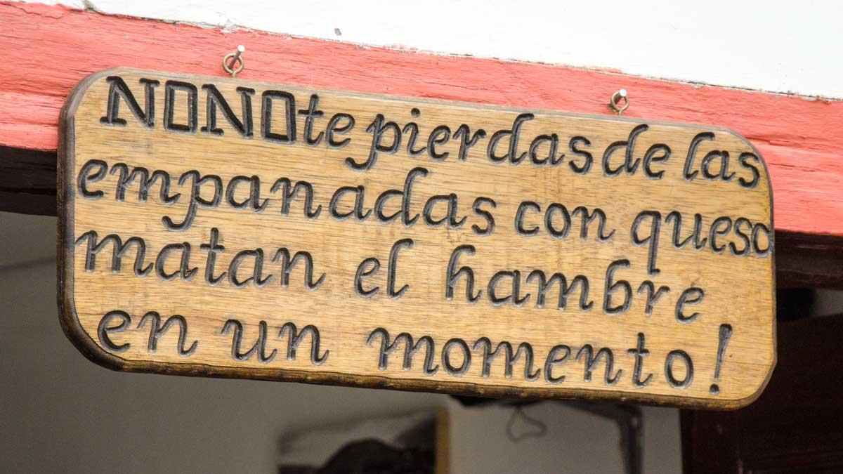 Sign outside La Casa de La Empanada, Nono, Ecuador   ©Angela Drake
