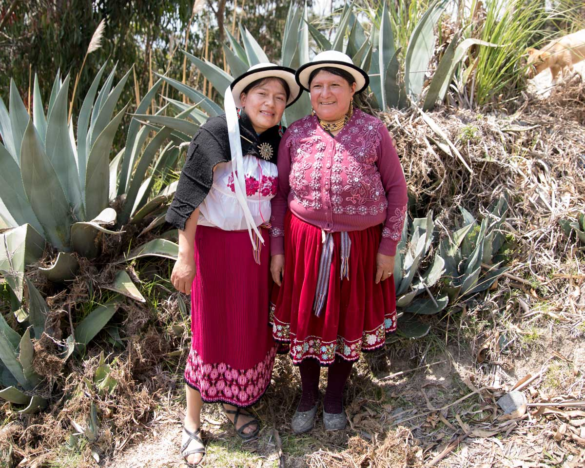 Tamia and her Mother wear bright clothes typical in the Cañar Province of Ecuador| ©Angela Drake