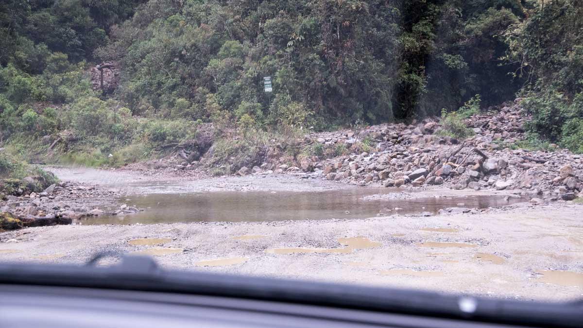 A small stream running across Highway 682 | ©Angela Drake