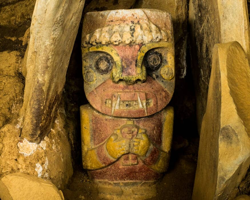 Detail of a painted figure holding a child, La Pelota, San Agustin, Colombia | ©Ernest Scott Drake