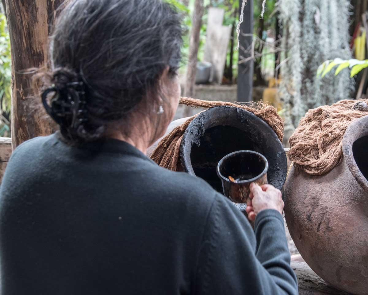 Scooping Indigo Blue for dying macana fibers; La Casa de la Macana, Gualaceo, Ecuador | ©Angela Drake