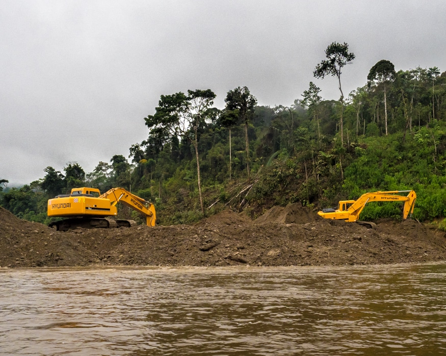These two machines were changing the course of a quarter mile long stretch of the Nangartiza River. |© Ernest Scott Drake
