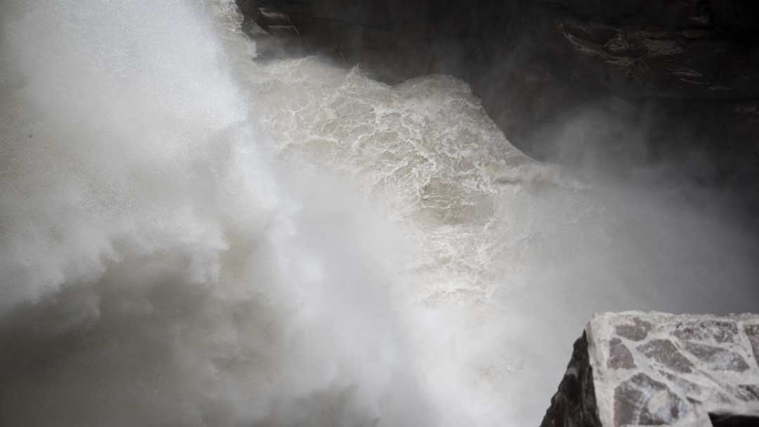 Water pouring into the Devil's Cauldron, (Pailon del Diablo), Rio Verde, Ecuador   ©Angela Drake