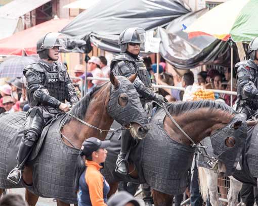 Police on horseback; Mama Negra Parade, Latacunga, Ecuador   ©Angela Drake