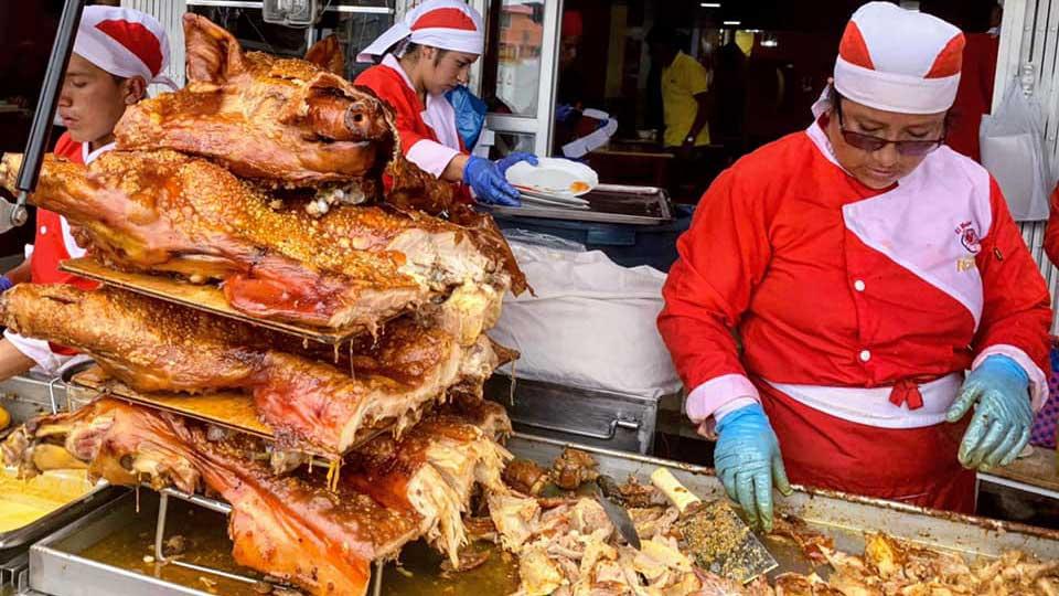 Hornado at the Mercado Iñaquito, Quito, Ecuador | ©Angela Drake